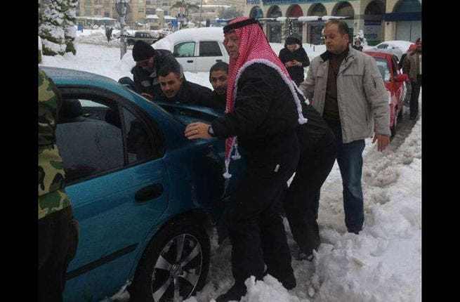 """King of Jordan: King Abdullah scored some mega 'man of the people' points with his latest photo-op pushing cars out of the snow with locals during storm Alexa.  To keep up the good press, in 2014, the Hashemite king should plan a weekly photo-op with the """"common folk."""" After all, what better way to keep a Jordanian """"spring"""" at bay?"""