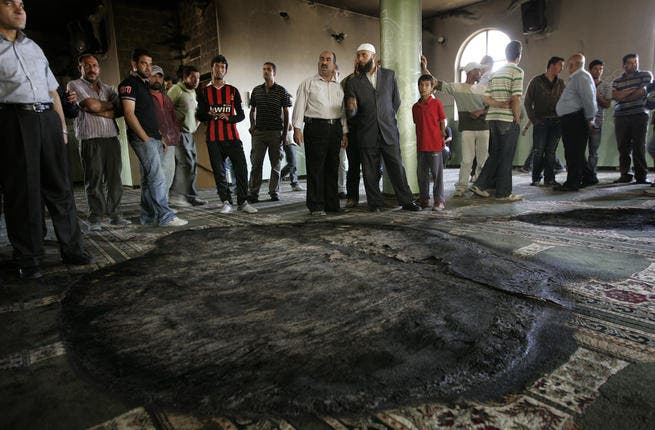 Arson attack on mosque near Ramallah defies any spirit of hope: the burning of a mosque early June by Israeli settlers
