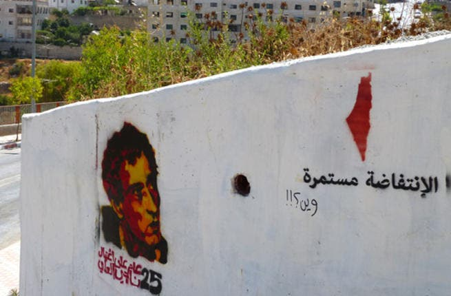 """""""The Intifada continues"""" says a stencil tag with a red outline of the map of Israel and the Palestinian territories on this Ramallah wall. Below it someone wrote """"Where?"""" The walls are not only used to get messages across but also for others to answer back."""