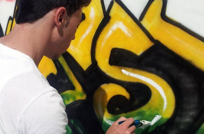 A young Palestinian tags the word