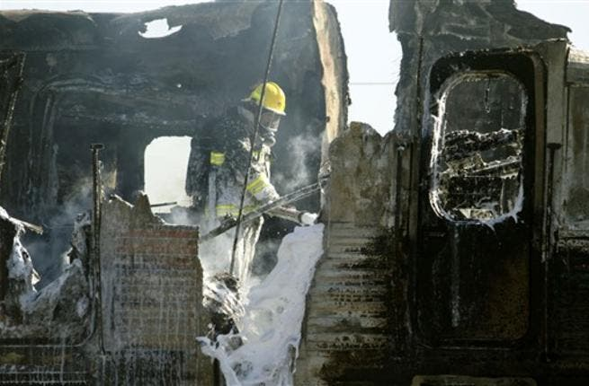 Israeli fire fighters are still trying to extinguish the flames of a burning train wreck.