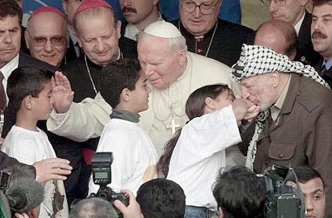 Taking a slight detour during his visit to Bethlehem, Pope John Paul II looked in on the 'needy' of nearby Dheisheh Refugee Camp, also accompanied by Yasser Arafat. He took the opportunity to call for an end to the suffering of homeless Palestinians, appealing to world leaders to step in.