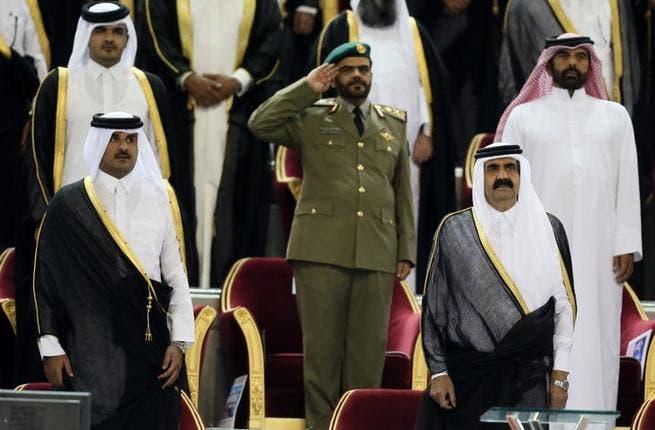 Emir Sheikh Hamad bin Khalifa al-Thani (R) standing next to his son Sheikh Tamim bin Hamad al-Thani (L) before the Emir Cup final match between Al-Sadd and Al-Rayyan at Khalifa stadium in Doha (AFP)