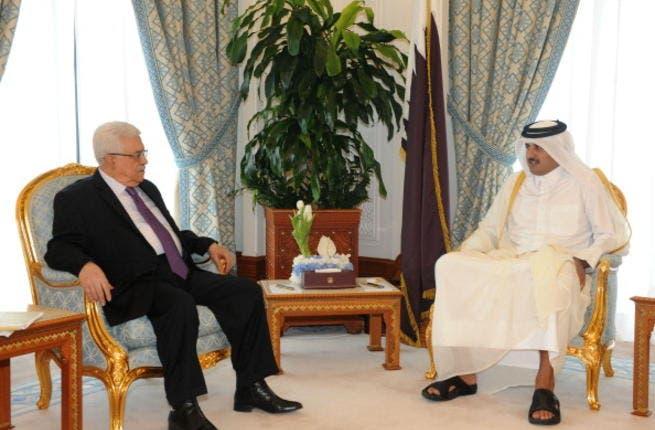 Palestinian President Mahmoud Abbas (L) meets Sheikh Tamim bin Hamad on February 6, 2012 in Doha, Qatar (Getty)