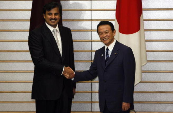 Sheikh Tamim Bin Hamad Al Thani is greeted by Japanese Prime Minister Taro Aso before a meeting in Tokyo (Getty)