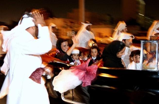 Sheikha Moza bint Nasser al-Missned (car L), wife of Qatari Emir Sheikh Hamad bin Khalifa al-Thani, waves to the crowds as she arrives with her grandchildren to Doha coming from Zurich.