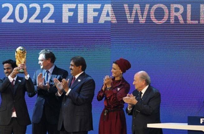 Sheikh Mohammed bin Hamad al-Thani, chairman of the Qatar 2022 bid committee, (L) raises the World Cup trophy as he stands with Qatar's Emir Sheikh Hamad bin Khalifa al-Thani (C), his wife Sheikha Moza and FIFA president Joseph Blatter (R).