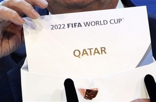 FIFA president Joseph Blatter opens the envelope to reveal that Qatar will host the 2022 World Cup at the FIFAheadquarters in Zurich.