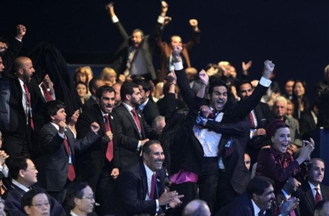 Members of the Qatari delegation celebrate following the official announcement of the 2022 World Cup host country at the FIFA headquarters in Zurich.