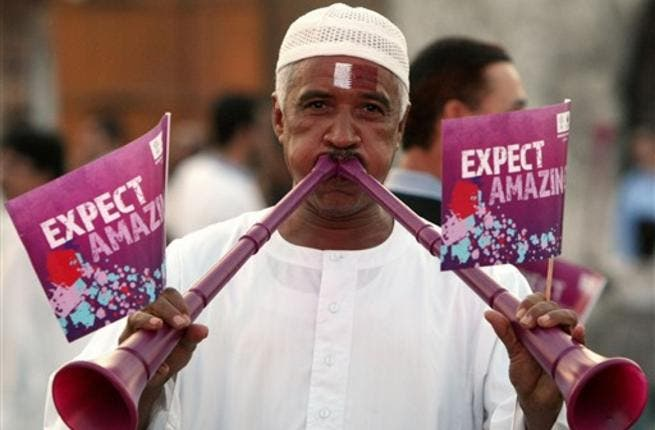 A Qatari man blows vuvuzela trumpets at Doha's traditional souk as people gather to follow FIFA's decision on who will host the 2022 World Cup.