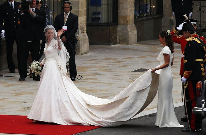 THE dress:10 years later she trades 'that' dress for this: Ivory ballgown from Alexander McQueen- a throwback to Grace Kelly's elegance- and model for brides-to-be who want that Catherine look complete with lacey arms. THIS dress walked down the mother-of-all catwalks, the Royal aisle & red carpet.