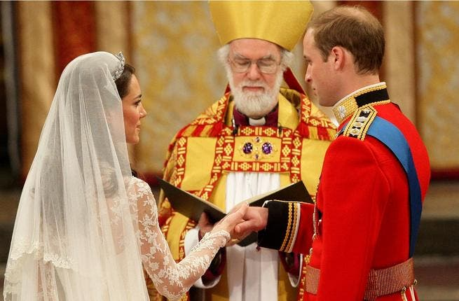Still not a falter at the alter: And no wonder  when her Prince has just whispered the reassuring 'You look beautiful' as the Archbishop of Canterbury proceeds to 'marry' them, and pronounce them Man and Wife (in this case Duke and Duchess).