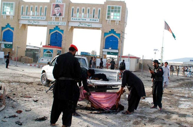 Ramadan has barely made its presence felt on the Pakistani-Afghan border: Security officials remove a body following an explosion in the Pakistani town Chaman earlier this month. At least two people were killed with eight others wounded. (AFP PHOTO / ASGHAR ACHAKZAI)