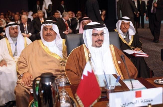 Crown Prince of Bahrain Sheikh Salman bin Hamad al-Khalifa (front) and Foreign Minister Sheikh Khalid bin Ahmed Al-Khalifa (2nd L).