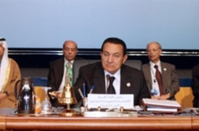 Egyptian President Hosni Mubarak chairs the opening session of the second Arab Economic Summit, with Kuwait's emir Sheikh Sabah al-Ahmad al-Sabah and Arab League Secretary General Amr Mussa.
