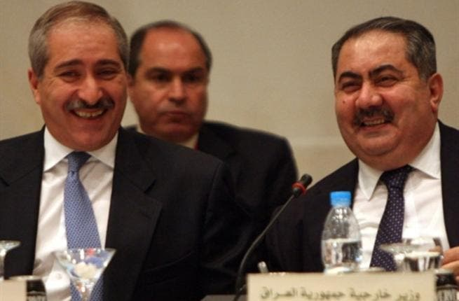 Foreign Ministers from Jordan Nasser Judeh (L) and Iraq Hoshyar Zebari.