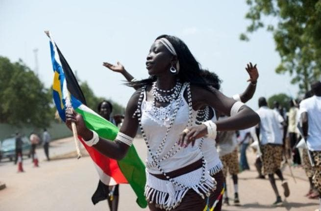 Women from a cultural dance troupe parade through Juba.