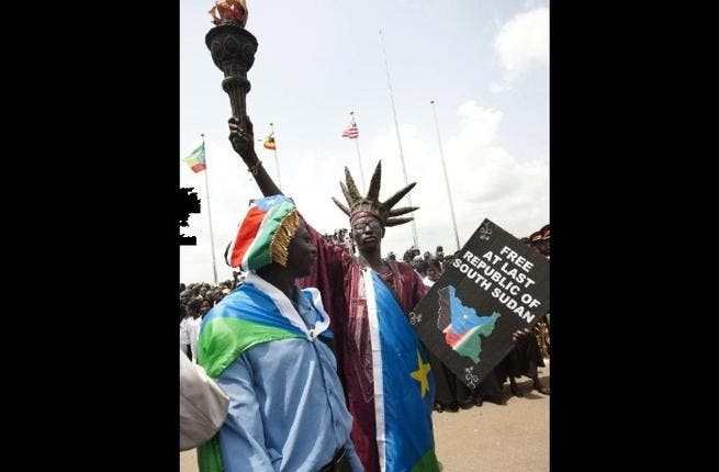 A South Sudanese man disguised as the Statue of Liberty of the US attends celebrations marking South Sudan's independence in Juba  as it seceded from the north and became the world's newest nation.