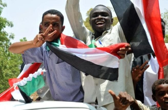 Sudanese wave their national flag as they celebrate in Khartoum after South Sudan proclaimed independence from the north, creating the world's newest nation and splitting Africa's largest country in two.