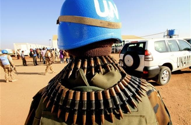 UN peace keepers secure the area as Qatari Minister of State for Foreign Affairs Ahmed bin Abdullah al-Mahmud arrives in Darfur.
