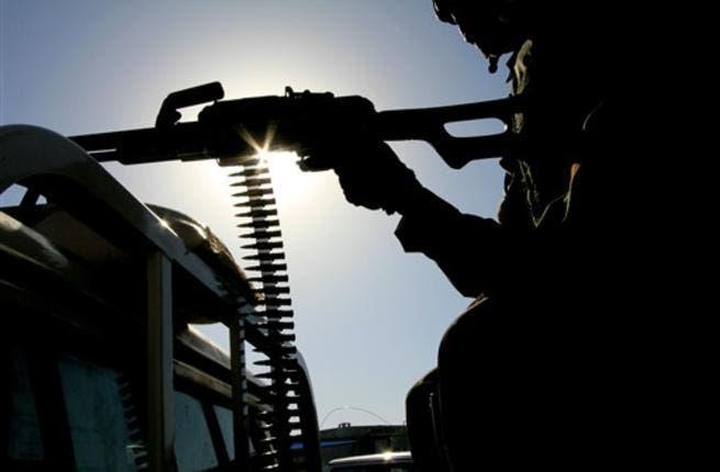 A UN peace keeper mans a machine gun as security remains tight.