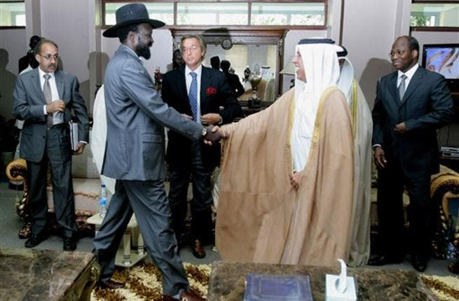 Qatari Minister of State for Foreign Affairs Ahmed bin Abdullah al-Mahmud (C-R) shakes hands with South Sudan leader Salva Kiir as he arrives with Djibril Bassole, chief negotiator for the UN and the African Union for a meeting in south Sudan's regional capital Juba.