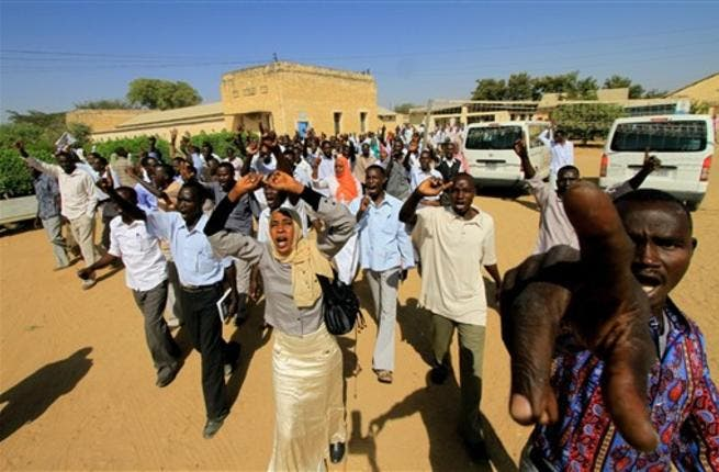 Sudanese students shout slogans during a protest against the visit of Darfur mediators from Qatar and the UN outside the University of Zalingei.