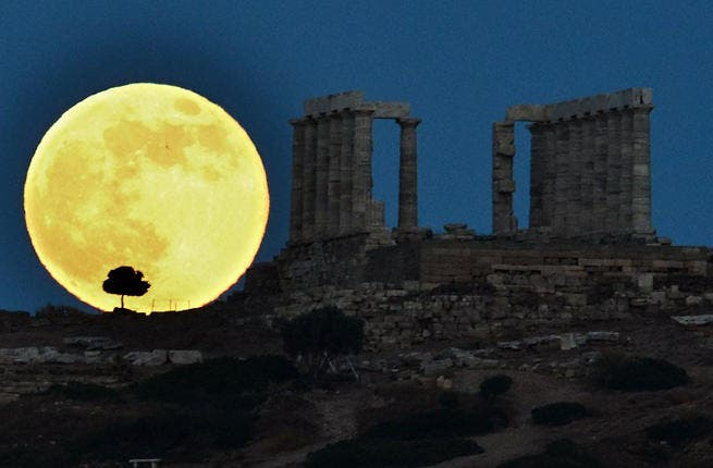 Supermoon next to ruins in Greece.