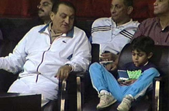 Potential heir nipped in the bud: The presidential couple's young grandson, Muhammad Mubarak, died aged 12 from complications of a health crisis. The eldest grandson of Presiden Mubarak , son of Alaa Mubarak, a businessman not involved in politics, here watching a sports game with Grandpa.