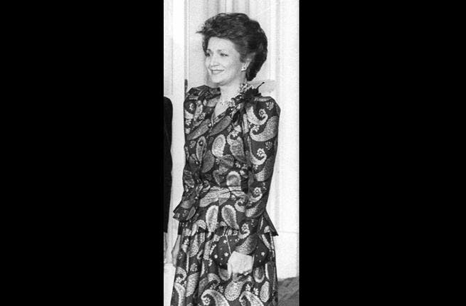 Played the high life but lived a 'low life', marked by dishonesty. She merged personal and philanthropic funds, most notoriously from the Alexandria Library. Here in 1988 pictured at a dinner at the White House, enjoying the glitz of state functions.