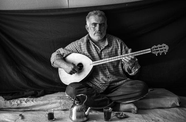 Despite fleeing for his life from his home in Damascus to the Domiz refugee camp in Northern Iraq, Omar, 37, made sure to bring his most precious possession with him: his lute. He joined over 100,000 other refugees willing to risk unstable Iraq to escape the horrors of Syria. (Photo UNHCR/ B. Sokol)