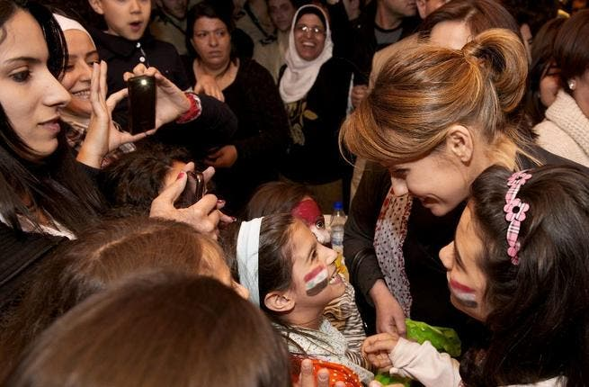 Asma Assad and her children attend a fundraising event in Damascus