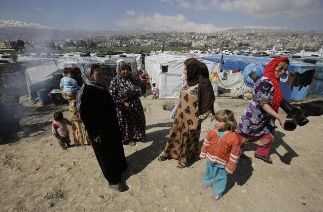 Syrian refugees at a makeshift camp in Lebanon (AFP)