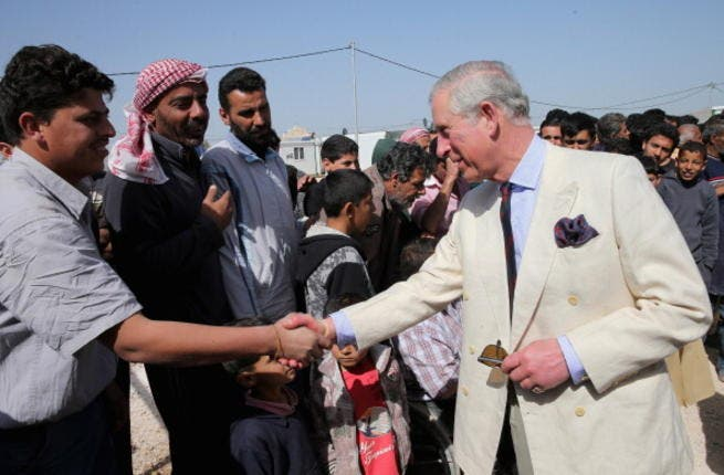 """The Prince of Wales and the Duchess of Cornwall came face to face with the human cost of the Syrian conflict when they visited Jordan's King Abdullah Park camp, which is home to just under a 1,000 people. Prince Charles described the refugees' plight as """"heartbreaking""""."""