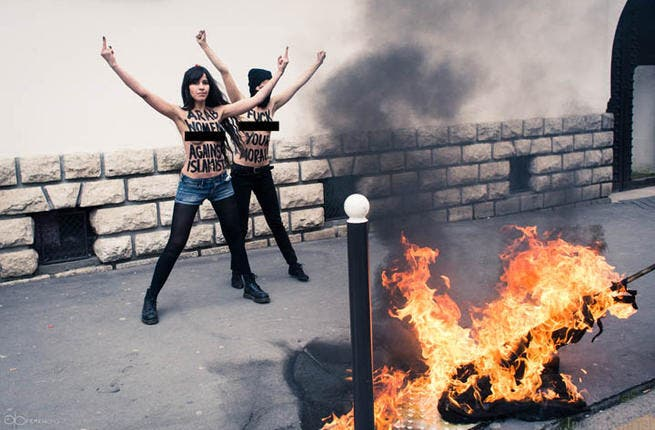 "FEMEN's 'topless jihad' is being aimed at religious extremism across the world, particularly focusing on Islam. In a provocative move, the group of female anti-oppression warriors, variously billed 'peaceful terrorists' set a salfist flag ablaze outside a mosque in Paris to protest against those who ""kill and rape in the name of Allah""."