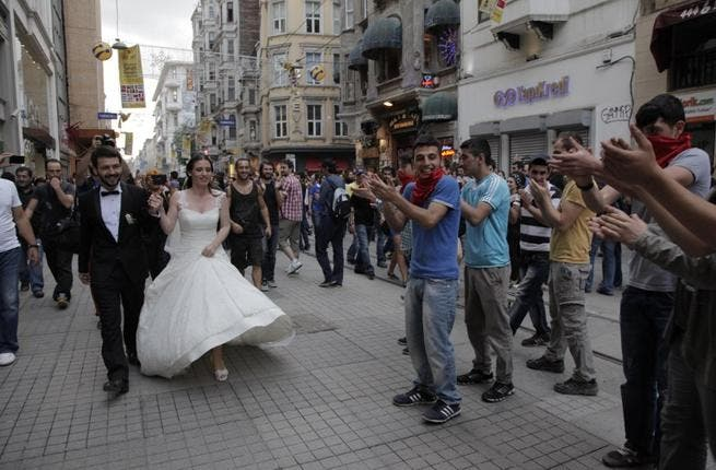 It's all about peace, love and urban planning down at Taksim square, so what better place to head with your brand new life partner. The happy couple received quite the reception! Let's hope she changed out of that dress before she met a Turkish policeman