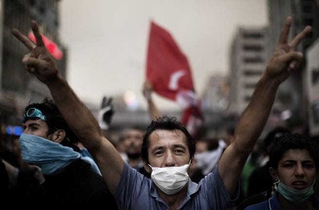Face-mask, double victory sign, this Ankara demonstrator knows exactly how to do it. Huge rallies were held after the government apologised to wounded protesters and said it had 'learnt its lesson'