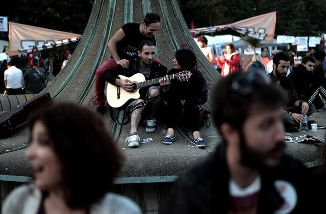 The Gezi Park protest quickly took on the feel of a summer music festival, as students lounged around on the grass, drinking beer and eating out of plastic trays, so it was inevitable 'the guy with the guitar' would show up to strum a little Pink Floyd
