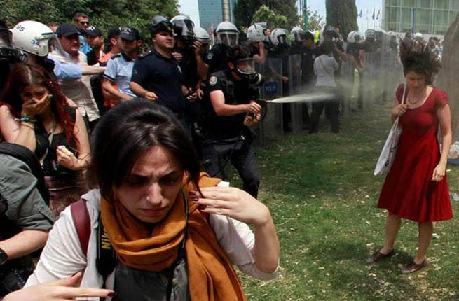 """Hair flailing as she's hit with a powerful blast of tear gas, the 'woman in red' has become the reluctant icon of the Gezi Park protests. Istanbul-based academic Ceyda Sungar told the Daily Mail """"Every citizen defending their urban rights...has witnessed the police violence I experience"""""""