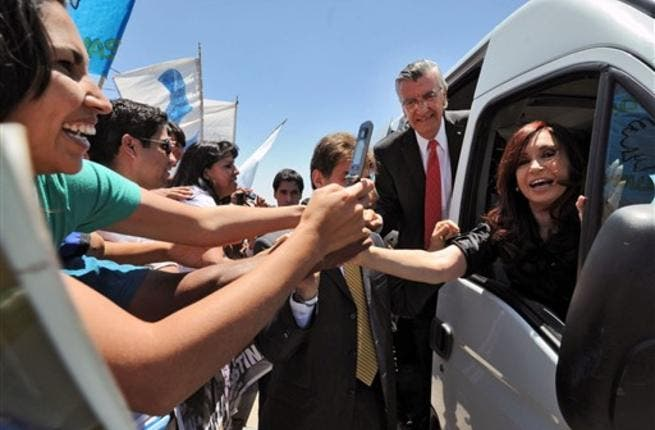 P.Cristina Kirchner greeting supporters during the inauguration of the school