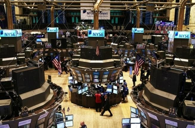 Traders work on the floor of the New York Stock Exchange in New York City. U.S. Attorney General Eric Holder announced yesterday that the Justice Department is conducting a criminal investigation of Wall Street.