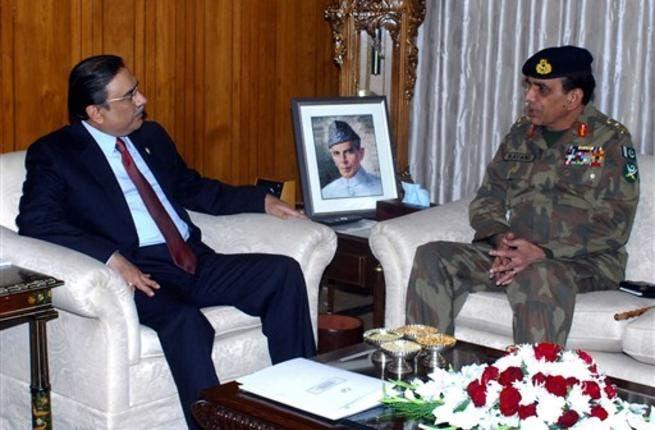 Pakistani Army Chief General Ashfaq Kayani (R) talking with Pakistan's President Asif Ali Zardari. Leaked memos exposed deep tensions between the United States and Pakistan on nuclear arms safety, and revealed how the army considered forcing out a president who dreads his own assassination.