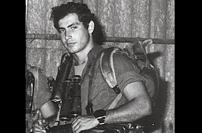 Who is the leader behind this handsome face? He hasn't grown out of his gun-totting ways, but is even more threatening now at the helm of the state of Israel. Clue: It's all in that arresting deep voice. It's none other than Israeli PM Benjamin Netanyahu, before taking the reigns of an unpopular state took its toll on his hairline.
