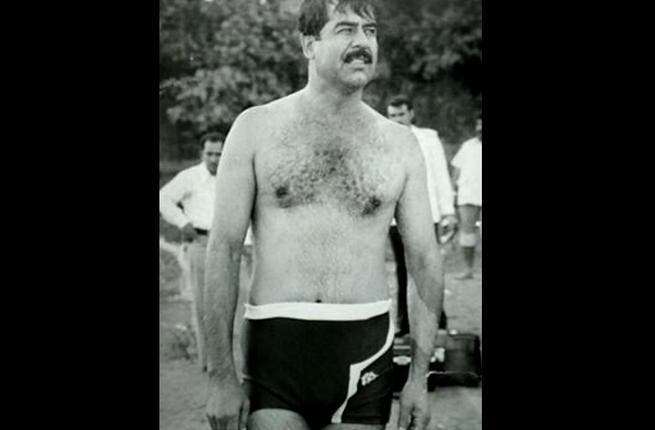 Saddam Hussein. Back when speedos were more accepted, Saddam was never too modest, whether flaunting his tell-tale, signature tache, or invading neighbors in front of the camera. The giveaway is that distinctive, Michael Douglas-esque chin. But had that evil glint in his eye early on.