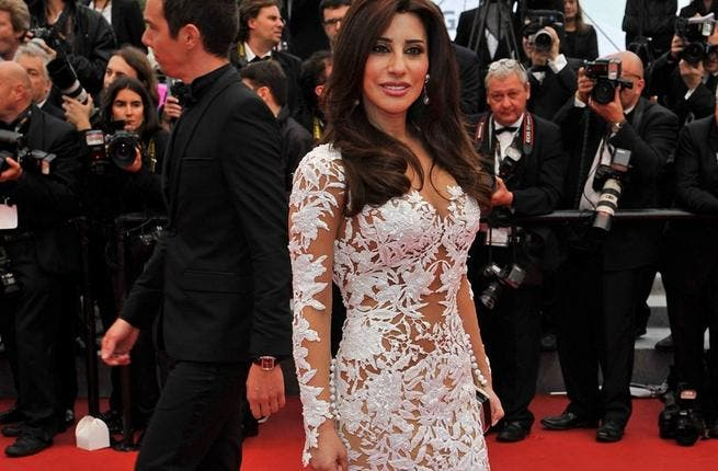 Every Arabs favorite glamorous Lebanese singer, Najwa Karam. All dressed in white and representing cosmetics giant L'Oreal, the star looked comfortable posing for photographers in her slightly scandalous gown.