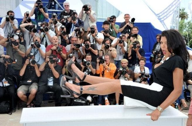 Nahed enjoys a knees-up at Cannes! Not quite her ladylike-self, Egyptian starlet, Nahed al Sabahi was snapped in a revealing dress posing with her legs up in the air. The pictures have caused a stir, even among other racy highlights at the festival.