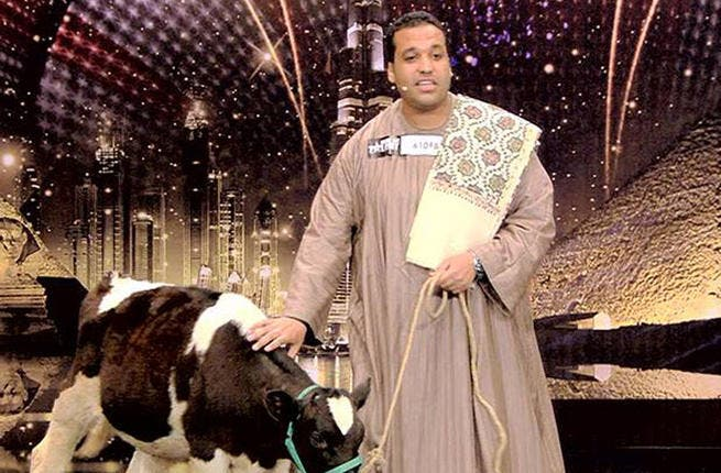 """Mad-cow disease? More like mad about the cow. We get cow-worship, but Egyptian Mohammad Atiyyeh's talent is serenading his bovine beast! This AGT act was described as """"not right in the head"""".  Atiyyeh lugged his cow """"Soso"""" from Egypt and recited a love poem - self-penned- to her. It was bye for Mo and his beloved (the cow not the Mrs)."""