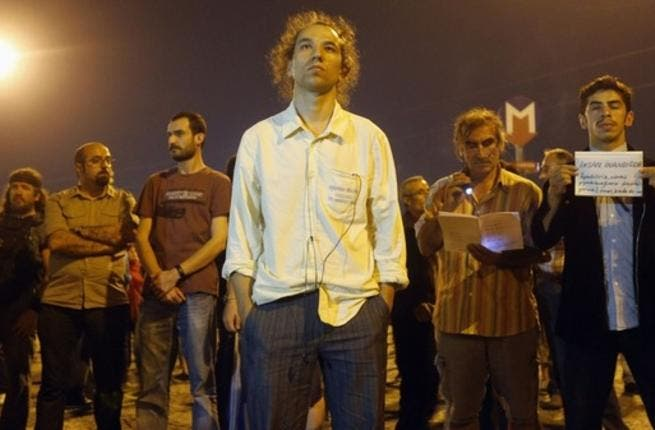 Erdem Gundus, pictured here, sparked a protest by standing silently for hours in Taksim Square in Istanbul overnight. He is currently trending on Twitter under the hashtag #StandingMan.
