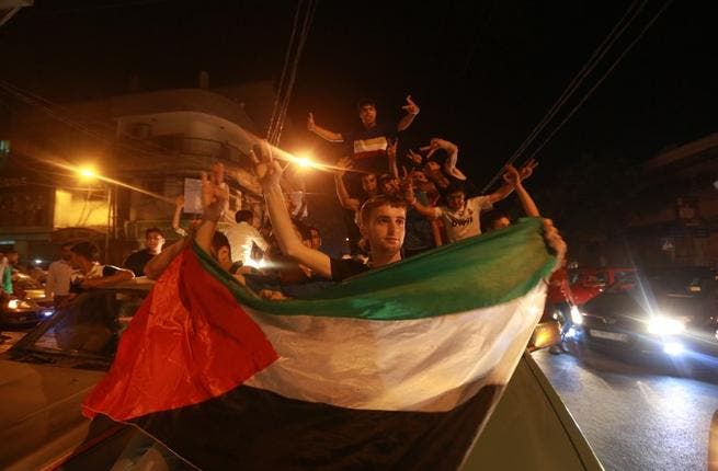 In northern Lebanon, Palestinian refugees in the Beddawi camp fired gunshots into the air and took to the streets, honking their car horns to celebrate Assaf's win. Traffic in Gaza ground to a halt as everyone flooded the streets in jubilation.