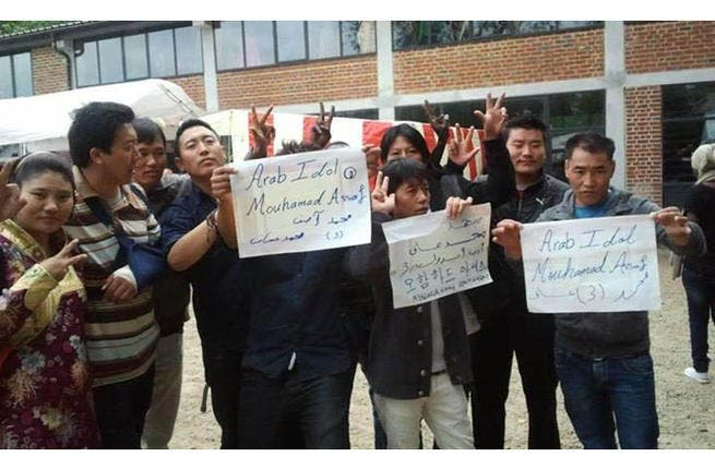 Even the Chinese couldn't resist Assaf-mania. Folks in China held signs in support of the Palestinian performer.